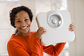 woman holding a weight scale